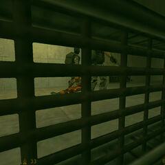 Calhoun viendo a los Soldados llevándose a Freeman al compactador de basura