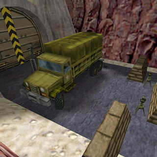 Camión estacionado cerca de dos torretas centinela