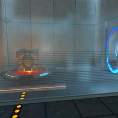 Cámara del botón, con el cubo y el portal temporal abierto