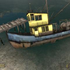 Barco pesquero Volcado en el pueblo costero de St. Olga