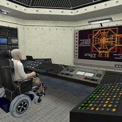 Dr. Keller en la sala de control bajo el espectrometro