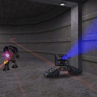 El cañón Xen disparando el haz azul de energía a Freeman