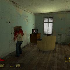Zombi en una habitación con un cadáver