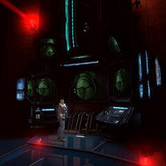 Alyx frente al monitor de la habitación