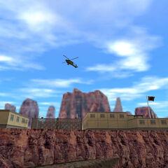 Apaches volando sobre el Area 8 Dormitorios de la Superficie Lateral