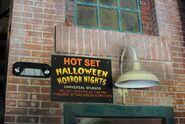 HHN Hallowd Past Hot Set Sign