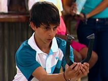 Rico throws horseshoe