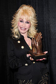 220px-Dolly Parton accepting Liseberg Applause Award 2010 portrait