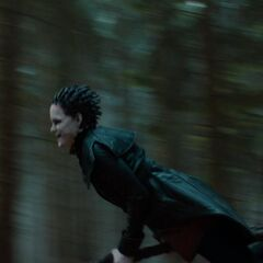 The Horned Witch evades Hansel and Gretel.