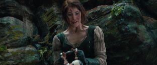 Gretel holds the taser