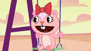 Giggles in the swing.PNG