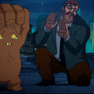 The Arm reluctantly leaves Commissioner Gordon for Clayface