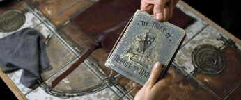 DH1 Scrimgeour passing The Tales of Beedle the Bard book to Hermione Granger