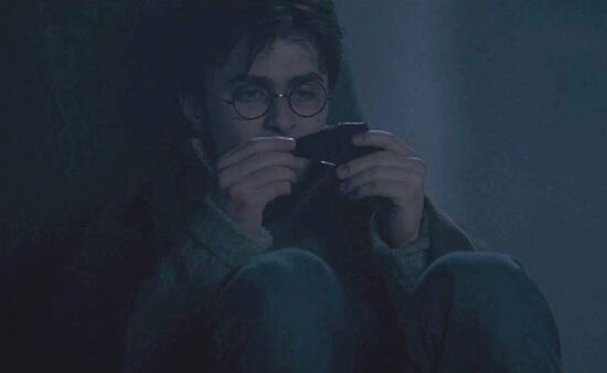 Harry Potter examining a shard of the Two-way Mirror given by Sirius Black