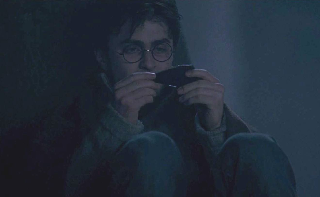Harry Potter examining a shard of the Two-way Mirror given by Sirius  Black.jpg