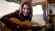 Natalia Tena playing guitar while in Tonks costume 03