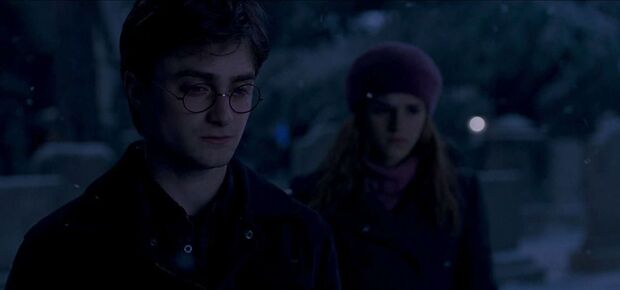 A teary Harry Potter with Hermione Granger at Godric's Hollow