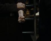 Karkaroff showing Snape his mark