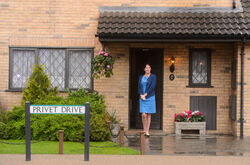 Fiona Shaw outside Privet Drive