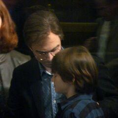 Гарри, его жена Джинни и их сын Альбус Северус