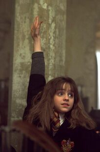 Hermione with her Hand Up