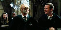 Draco has spider on his face