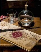 The Marauder's Map with Harry Potter's wand and spectacles