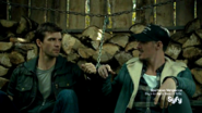 Nathan and Duke handcuffed together