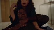 Marisa strangling Benjamin