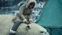 Lyra rides Iorek