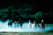 Fireflys leading captive teens to the cemetary