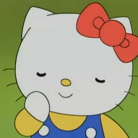 Hello Kitty smiling with her eyes closed.