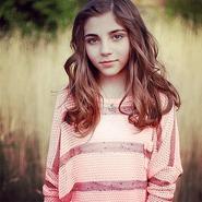 Jada wearing a pink shirt