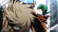 Izuku punches Katsuki