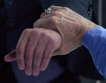 Powers Arthur grabs Adam's hand
