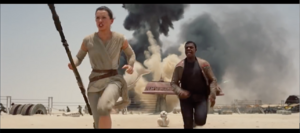Rey Finn and BB 8 escaping from First Order TIE Fighters