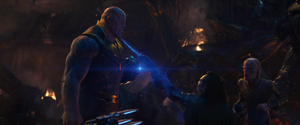Loki fails to kill Thanos