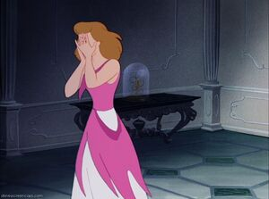 Cinderella crying after Lady Tremaine and her stepsisters ruined her dress