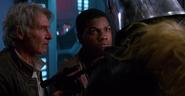 Finn, Chewbacca, and Han Solo capturing Captain Phasma