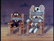 Danger Mouse and Penfold talking through their gags