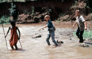 Ted, Susan and Morogo crossing the river