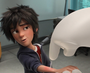 Baymax spraying Hiro's arm with bacitracin