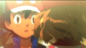 Ash receiving a kiss from Serena
