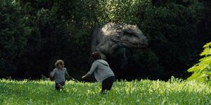 Zach and Grey fleeing from I-Rex