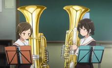 Kazuki and Riko holding the Tuba