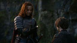 Jaqen le da la moneda a Arya HBO