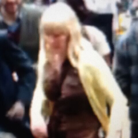 File:Yellow Jacketed Woman.jpg
