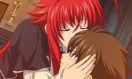Rias kissing Issei in the foreh