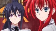 Akeno and Rias smiling at Ravel and Issei