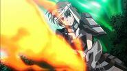 Karlamine emitting flame through her sword